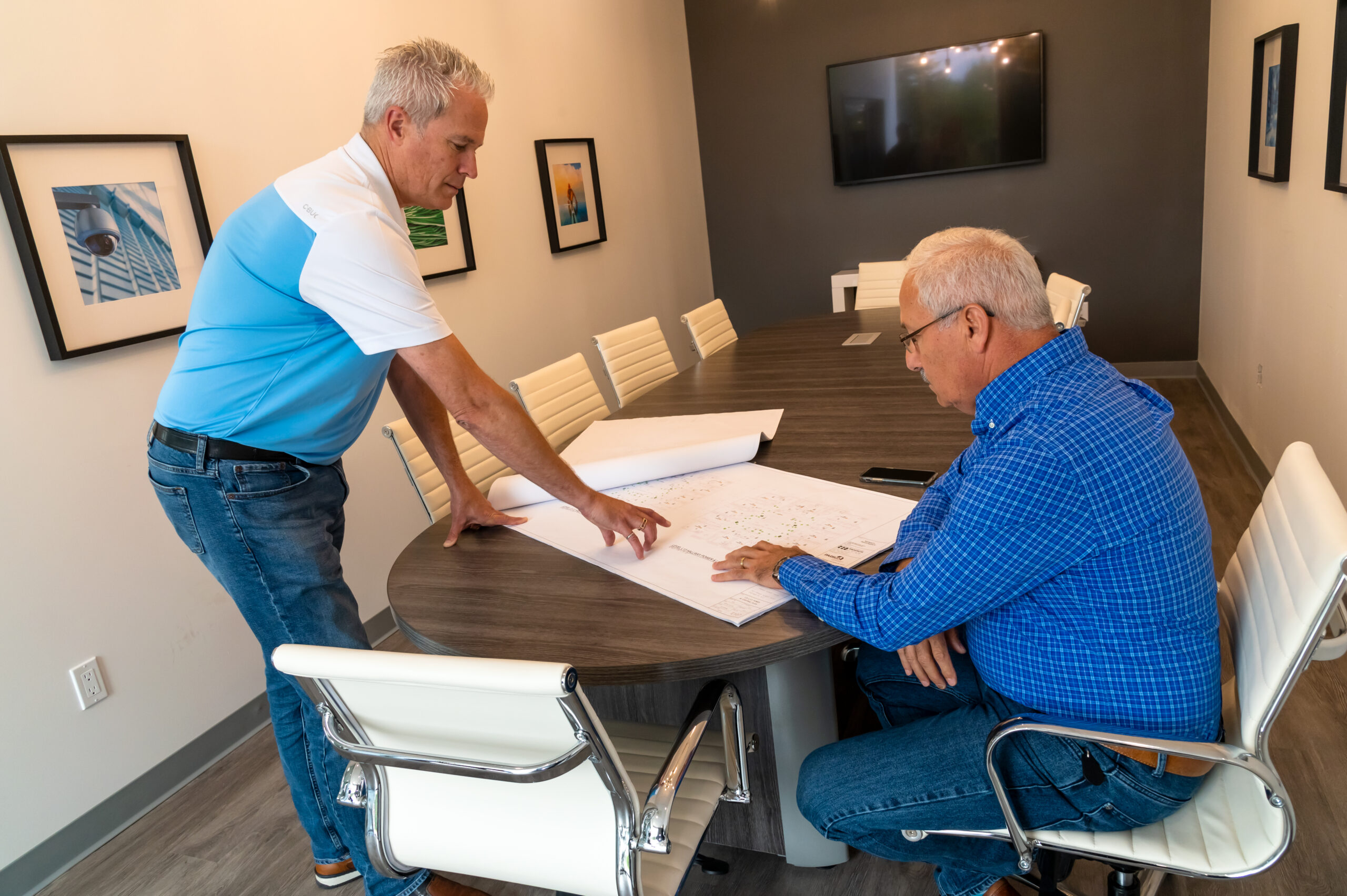PNL Electrical Contracting Looking Over Plans For a New Construction